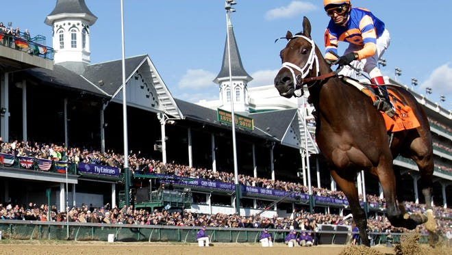 This Nov. 6, 2010, file photo shows John Velazquez riding Uncle Mo to victory during the Juvenile race at the Breeder's Cup horse races at Churchill Downs, in Louisville, Ky.