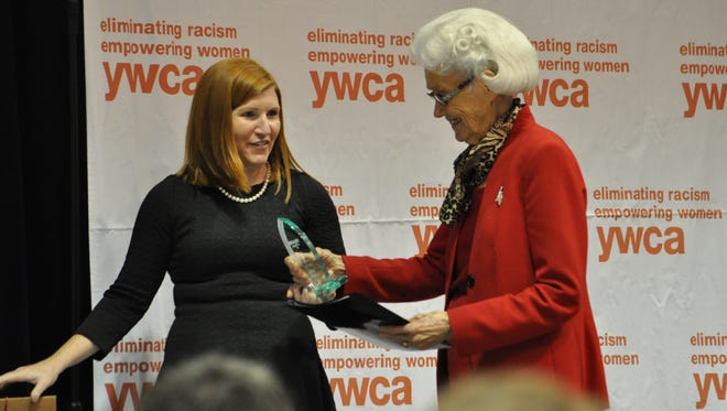 Katie Vanderlick, executive director at the YWCA of Alexandria-Pineville, presents a Distinguished Women of the Year award to Vesta Mangun on Thursday during the YWCA Alexandria-Pineville Decades of Women luncheon.