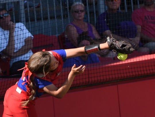 Lakewood catcher Tigan Braskie misses the catch on