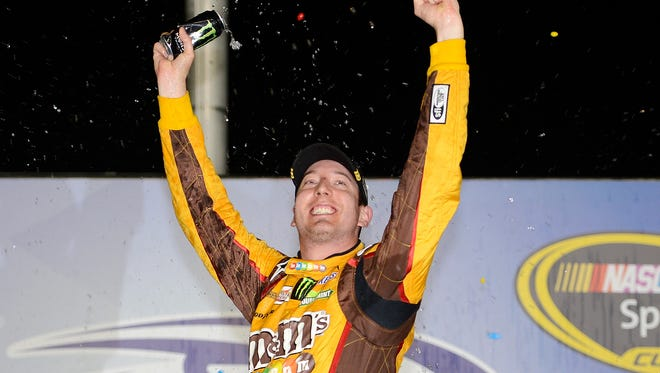 Kyle Busch, shown celebrating a NASCAR win, is headed back to Pensacola where he plans to compete in the 50th annual Snowball Derby on Dec. 3.