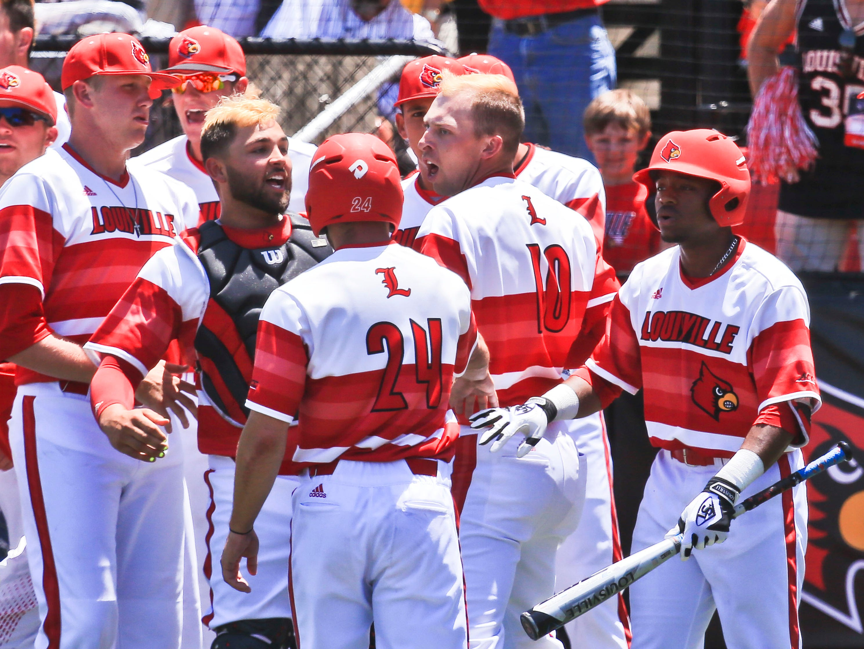 Drew Ellis yells back towards the Kentucky team as he greets teammates after his three-run homer sails over left field fence in the bottom of the fifth inning to put the Cards up 5-0 over Kentucky in the first game of the Super Regional Friday.
