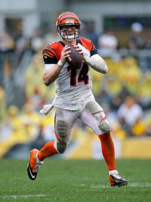 Cincinnati Bengals quarterback Andy Dalton (14) scrambles out of the pocket looking for an open receiver in the fourth quarter of the NFL Week 2 game between the Pittsburgh Steelers and the Cincinnati Bengals at Heinz Field in Pittsburgh on Sunday, Sept. 18, 2016. The Bengals fell to 1-1 with a 24-16 loss to the Steelers.