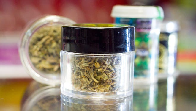 """Small jars of synthetic marijuana, commonly nicknamed """"Spice."""" Two people were arrested in Vanderburgh County late last month for allegedly manufacturing and selling synthetic cannabinoids like Spice."""