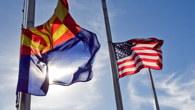 Flags flew at half staff near the Marine Corps Air Station in Yuma on Feb. 24, 2012, to honor seven Marines killed when two helicopters collided during a night mission about 65 miles from Yuma.