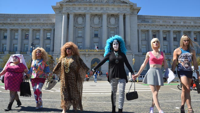 Members of the My Name Is campaign outside of San Francisco City Hall. The group is protesting a Facebook policy that allows members to call out those using fake names and have them be booted from the system. Sister Roma, a San Francisco drag queen who launched the protest, is in the center with blue hair and striped leggins.