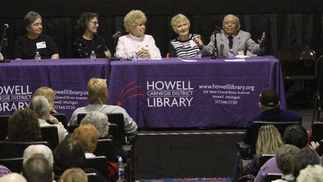 """Of personal relations between staff and Howell Sanatorium Doctors: """"I will never forget the camaraderie."""" said Dr. Ismael Yanga, right, during a forum Monday at the Howell Theater. """"We are all one great big family."""" he added. Other guests with connections to the former TB facility shared their own memories of the facility. From left: Deb Lonskey, Barbara Alchin, Nancy Fickies Calahan, Marilyn Wilkinson and Yanga. Steve Manor moderated the event, soliciting questions and memories from the audience in the packed."""