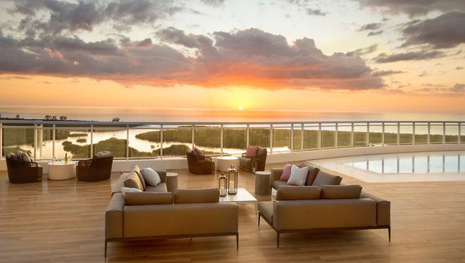 The deck surrounding the rooftop pool at Kalea Bay's first tower is now furnished with seating areas that look out toward the Gulf of Mexico.