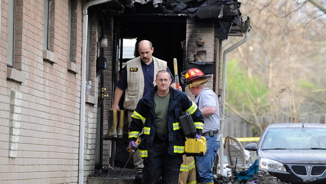 The Nashville Fire Department investigates a house fire that killed two people Thursday morning on Foster Street.