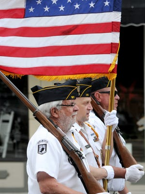 Members of the American Legion Post 181 Color Guard display the flag during the Memorial Day parade on Monday.