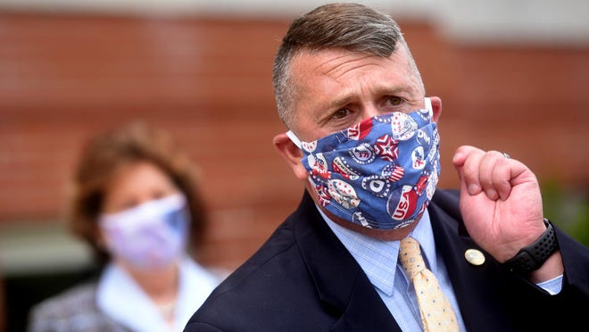 Somersworth Mayor Dana Hilliard, shown wearing a mask while endorsing U.S. Sen. Jeanne Shaheen, D-N.H., in August, says his city doesn't plan to follow others in adopting new emergency mask ordinances because officials prefer voluntary compliance and self-governance. However, he said city officials will continue to meet and reevaluate their COVID-19 plans if changes are needed.