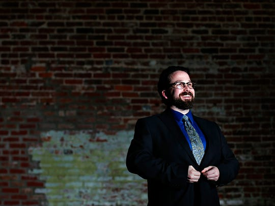 Nathan Shelton, recently named co-artistic director of Springfield Contemporary Theatre, poses for a portrait at the Old Glass Place in Springfield, Mo. on March 10, 2017.