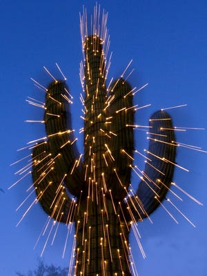 A saguaro cactus decorated with holiday lights in Scottsdale.