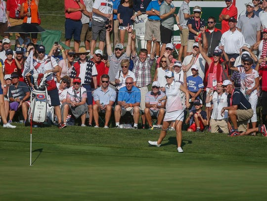 Fans react as USA's Austin Ernst hits a shot from on