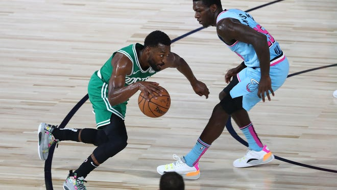 Celtics guard Kemba Walker tries to drive past Heat guard Kendrick Nunn during a regular-season game last month. The teams square off in Game 1 for the Eastern Conference title beginning on Tuesday night.