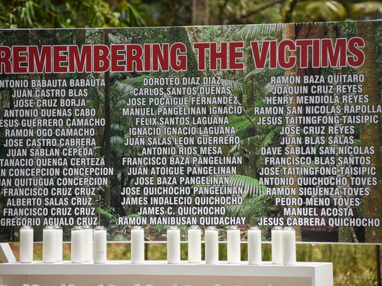 A sign bearing the names of the 45 Chamorro men killed in the Chagui'an massacre can be seen during a memorial service at the site in Yigo on Tuesday, Aug. 8, 2017. During the recapture of the northern part of Guam by American soldiers from Japanese Imperial armed forces in World War II, U.S. Marines discovered a Japanese truck loaded with the bodies of decapitated Chamorro men. A further search of the area after the gruesome discovery, resulted in the finding 21 men, remaining in a kneeling position with their hands bound behind their backs and all beheaded. A Mass and ceremony was held to remember the victims of the tragic massacre.