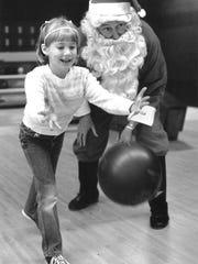 Santa instructs a young bowler Dec. 17, 1983, at Triangle