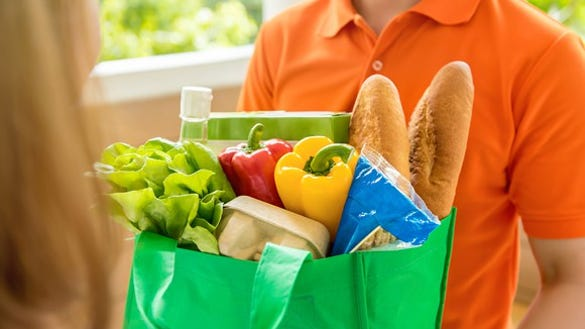 Man holding groceries.