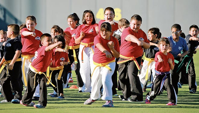 Karate kids showed off their skills during a demonstration prior to a Chihuahuas game.