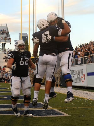 Ziad Damanhoury, right, celebrates with Jarred Gipson following a touchdown last season. Damanhoury has returned to the team following a DUI suspension.