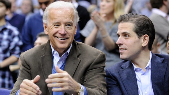 In this Jan. 30, 2010, file photo, Vice President Joe Biden and his son Hunter attend the Duke-Georgetown NCAA basketball game in Washington.