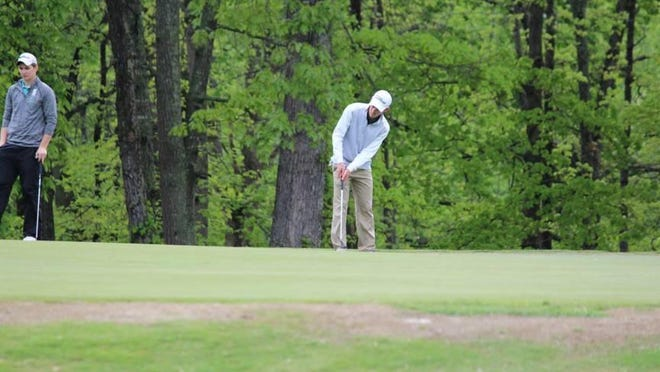 Sending a shot on its way during the recent NCCGA championships is Josh Heinze, whose first-place finish helped him earn a chance to make Michigan State's varsity team next season.