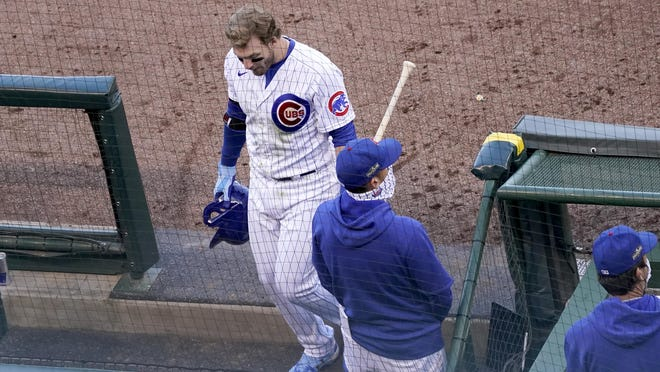 Chicago Cubs' Ian Happ heads off the field after the Cubs' 2-0 loss to the Miami Marlins in Game 2 of a National League wild-card baseball series Friday, Oct. 2, 2020, in Chicago. The Marlins won the series 2-0 to advance to the division series.