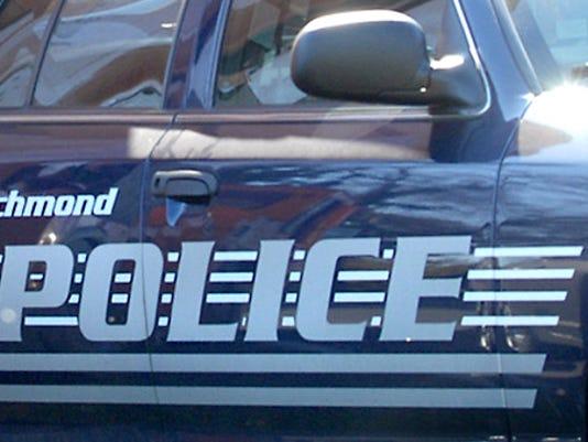 Trash truck totals Richmond police cruiser