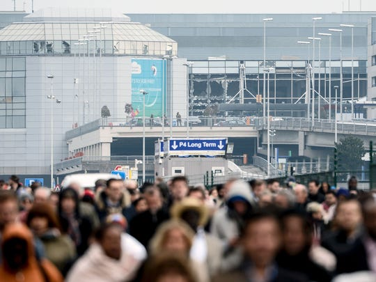 Passengers evacuate the Brussels Airport, in Zaventem,