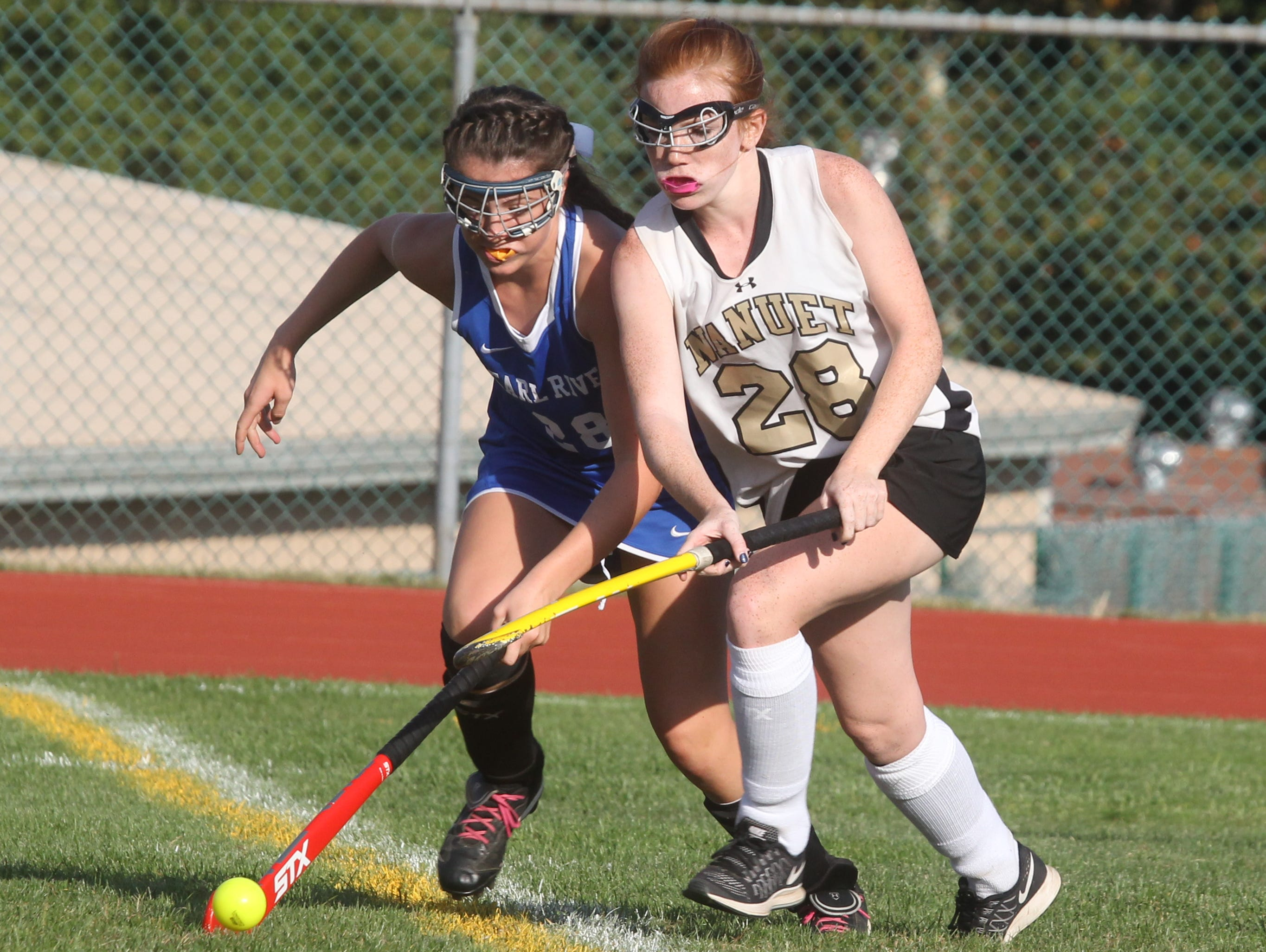 Pearl River's Allison Tarsnane, left, is pressured by Nanuet's Alex Ryan during their game at Nanuet on Friday. The game ended in a 0-0 tie.