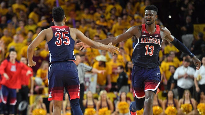 Arizona Wildcats guard Allonzo Trier (35) and forward Deandre Ayton (13) slap hands during the second half against the Arizona State Sun Devils at Wells-Fargo Arena.