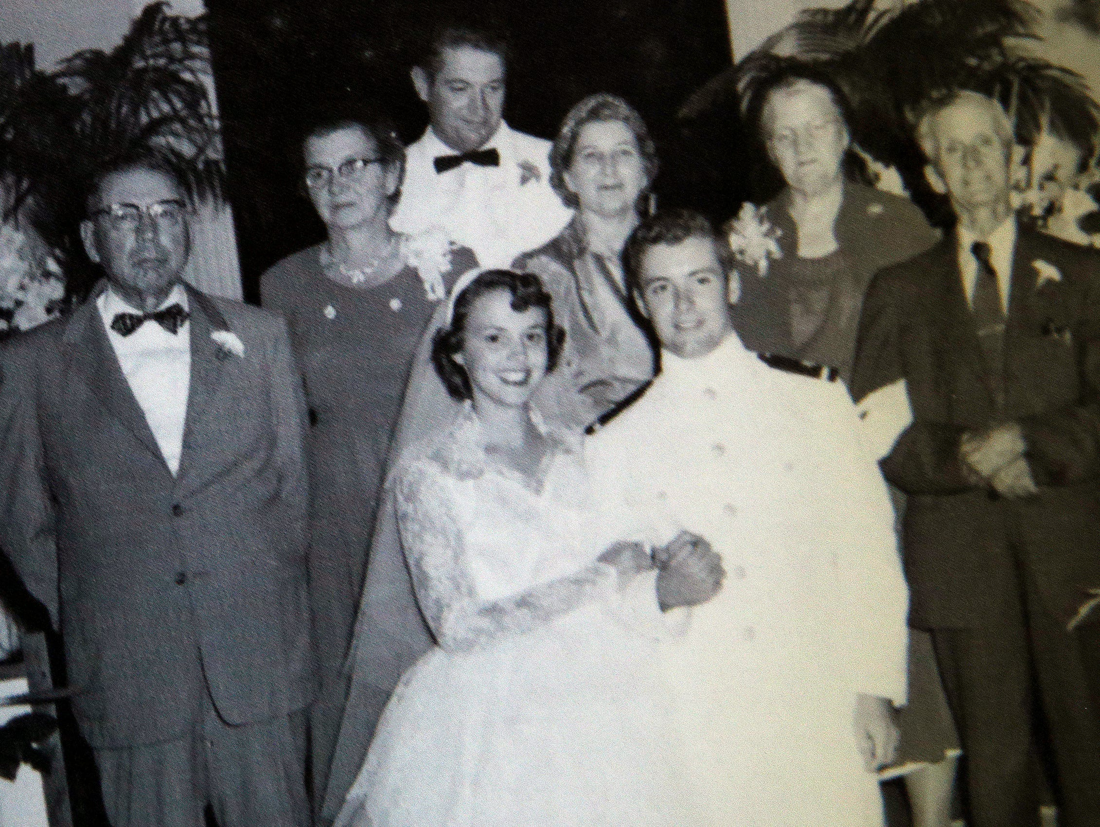 """""""My grandfather said I should wrap myself in the head with a hammer to grow the 1/2 inch I needed to become a pilot,"""" said Jim Graham, on June 28, 2016. Grahams grandfather, furthest to the left, is pictured in this wedding photo taken five hours after Grahams graduation from college."""