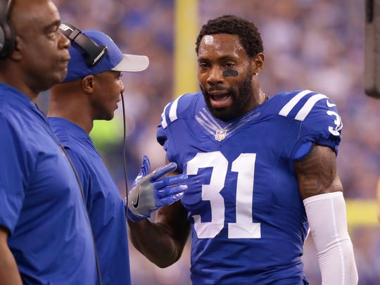 Indianapolis Colts cornerback Antonio Cromartie (31) talks with a coach on the sidelines during the first half of an NFL football game Sunday, Sept. 25, 2016, at Lucas Oil Stadium.