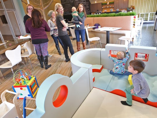 Parents chat with Tonya Bergeson-Dana (center) while kids play at the Urban Chalkboard in Carmel.