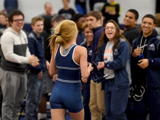 The teammates of West York's Carly Gross celebrate after her pin of Eastern York's Allen Miller during the Bulldog's 49-24 victory on Tuesday, Jan. 10, 2017.
