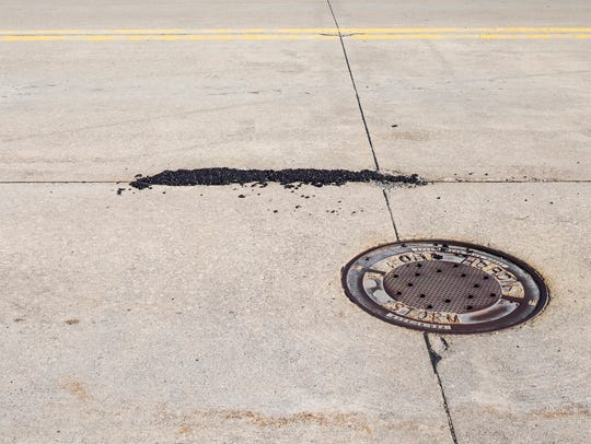Patched potholes along 10th Street in Port Huron, Feb.