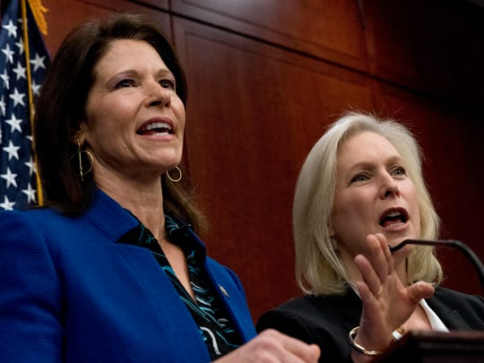 Rep. Cheri Bustos, D-Ill., left, and Sen. Kirsten Gillibrand, D-N.Y., right, speak at a news conference where members of congress have introduced legislation to curb sexual harassment in the workplace, on Capitol Hill, Wednesday, Dec. 6, 2017, in Washington. Gillibrand and fellow female Democratic senators have united in calling for Sen. Al Franken to resign amid sexual misconduct allegations.