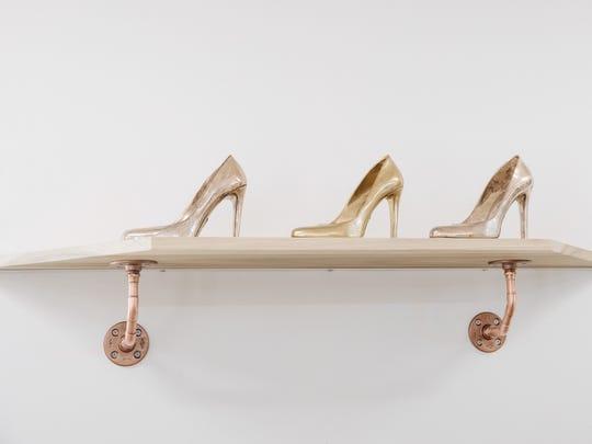 A trio of casted stilettos by artist Angel Chen in her studio in Joshua Tree