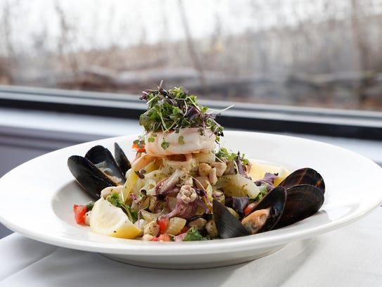 Chilled Seafood Salad Medley with calamari, prawns,