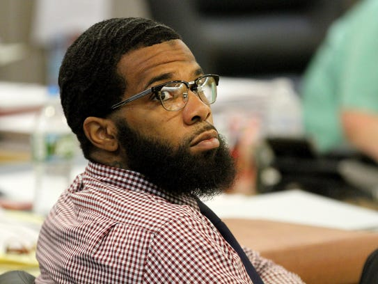 Haneef Walker is shown during his trial along with