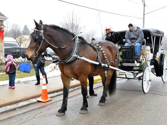 Horse drawn carriages, an appearance by Santa, caroling