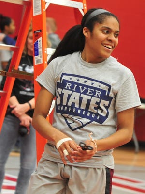 River States Conference Player of the Year Tia King cuts down the net after the IU East women's basketball team defeated IU Kokomo in the River States Conference tournament championship game Feb. 28, 2017.