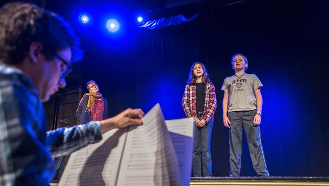 """Musical director Randal Pierce, from left, rehearses """"Brundibar: A Musical Tale"""" by Theatre Kavanah with Brittany Dunn, Zoe Hecht, and Nathan Brown at Contois Auditorium in Burlington on Thursday, March 3, 2016."""