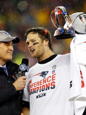 New England Patriots quarterback Tom Brady (12) celebrates with Lamar Hunt Trophy while being interviews by CBS announcer Jim Nantz after the New England Patriots beat the Indianapolis Colts in the AFC Championship Game at Gillette Stadium.