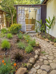 Drought-tolerant landscaping, including native plants, makes up much of this yard.