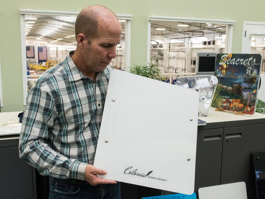Hardwire CEO George Tunis holds a Bulletproof Whiteboard