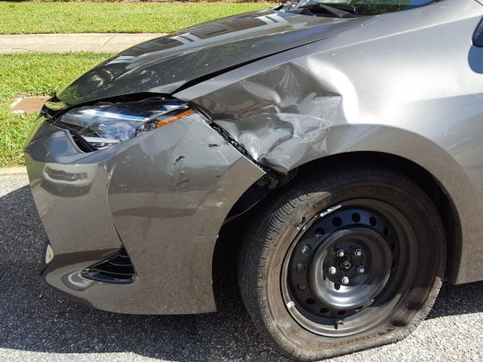 A car was possible damaged by gunfire while parked
