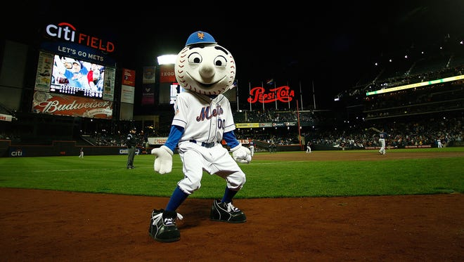 NEW YORK - APRIL 03:  Mr Met  gets the crowd going during an exhibition game between the New York Mets and the Boston Red Sox on April 3, 2009 at Citi Field in the Flushing neighborhood of the Queens borough of New York City. The game marks the first time the Mets play in their new ballpark.  (Photo by Mike Ehrmann/Getty Images)
