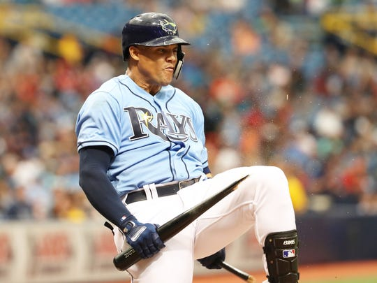 Tampa Bay Rays right fielder Carlos Gomez breaks his bat over his knee after stricking out during the fifth inning against the Minnesota Twins at Tropicana Field in St. Petersburg, Fla.
