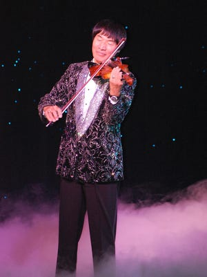Shoji Tabuchi plays country music during a recent performance.