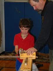 Fourth grade student Shane McCarthy enjoys some hands-on woodworking activities.